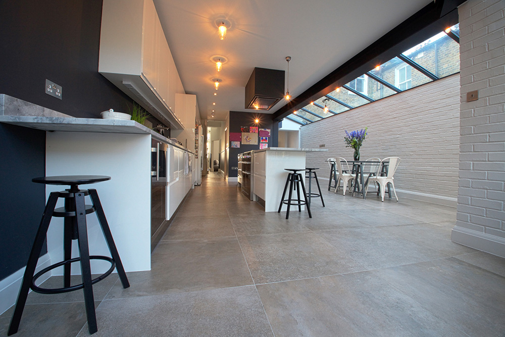 A House Extension that has created a large kitchen with a sleek breakfast bar.